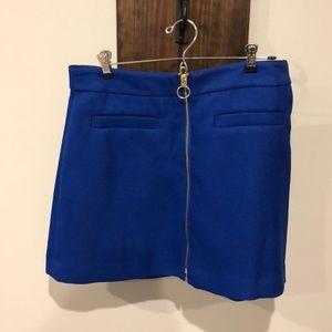 Blue mini skirt. Never been worn.